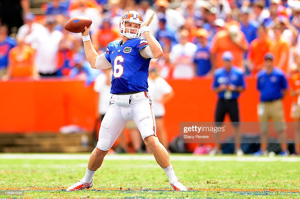 <a gi-track='captionPersonalityLinkClicked' href=/galleries/search?phrase=Jeff+Driskel&family=editorial&specificpeople=7639913 ng-click='$event.stopPropagation()'>Jeff Driskel</a> #6 of the Florida Gators looks for an opening against the Toldeo Rockets during a game at Ben Hill Griffin Stadium on August 31, 2013 in Gainesville, Florida. Florida won the game 24-6.