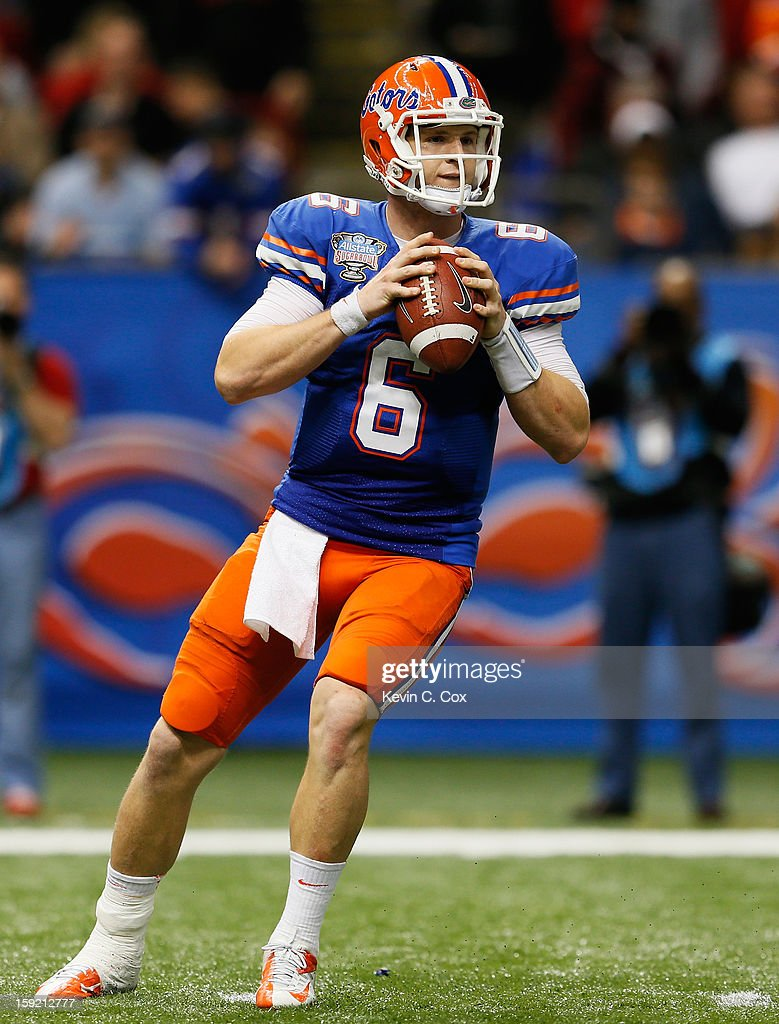 Jeff Driskel #6 of the Florida Gators looks to pass against the Louisville Cardinals during the Allstate Sugar Bowl at Mercedes-Benz Superdome on January 2, 2013 in New Orleans, Louisiana.