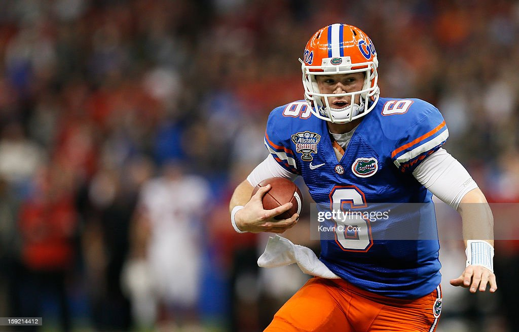 Jeff Driskel #6 of the Florida Gators runs against the Louisville Cardinals during the Allstate Sugar Bowl at Mercedes-Benz Superdome on January 2, 2013 in New Orleans, Louisiana.