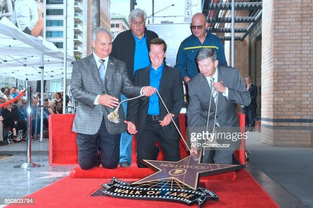 Jeff Dunham reacts as his Hollywood Walk of Fame Star is unveiled during a ceremony in Hollywood California on September 21 where he was the...