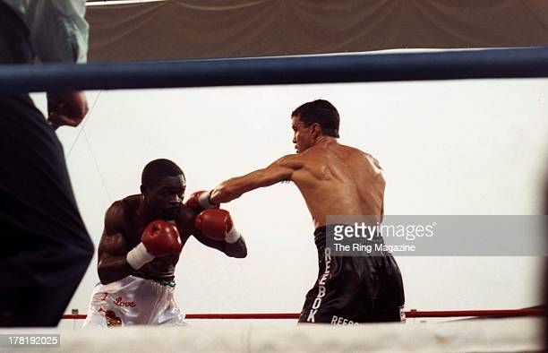 Jeff Fenech throws a punch against Azumah Nelson during the fight at Princes Park Football Ground in Melbourne Australia Azumah Nelson won the WBC...