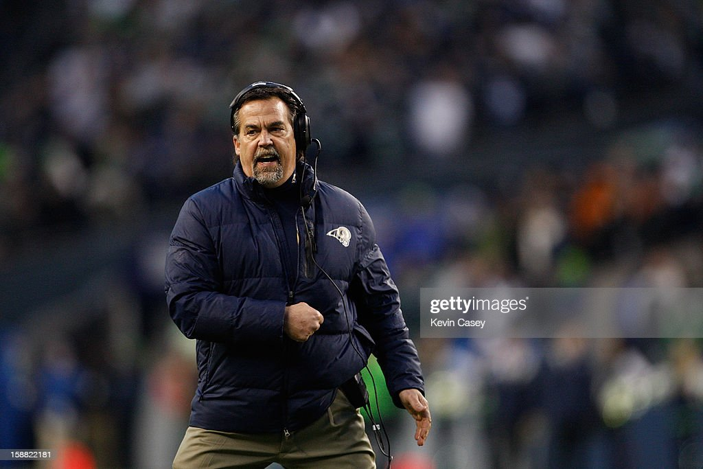 Jeff Fisher head coach of the St. Louis Rams cheers on his team late in the game against the Seattle Seahawks at CenturyLink Field on December 30, 2012 in Seattle, Washington.