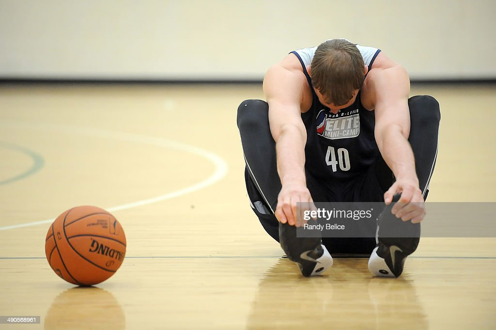 Jeff Foote #40 of the Springfield Armor stretches prior to the start of day two of the 2014 NBA Development League Elite Mini Camp on May 13, 2014 at Quest Multisport in Chicago, Illinois.