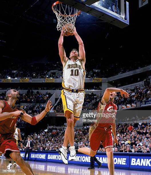 Jeff Foster of the Indiana Pacers goes to the basket during the NBA game against the Cleveland Cavaliers at Conseco Fieldhouse on December 15 2003 in...