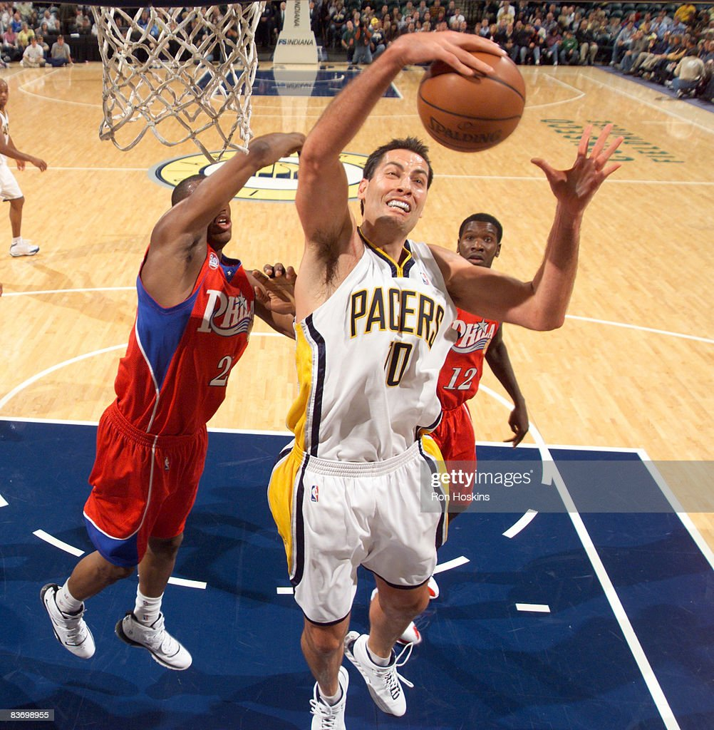90d98992834 ... Jeff Foster 10 of the Indiana Pacers rebounds over Thaddeus Young 21 of  the ...