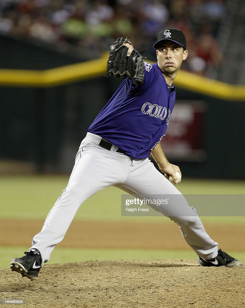 Jeff Francis of the Colorado Rockies delivers a pitch against the Arizona Diamondbacks during the eighth inning of a MLB game at Chase Field on...