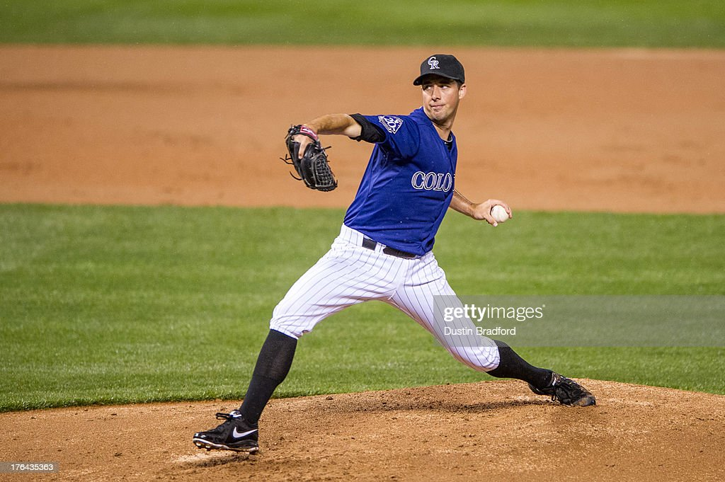 Jeff Francis of the Colorado Rockies pitches in the ninth inning off a game against the San Diego Padres at Coors Field on August 13 2013 in Denver...