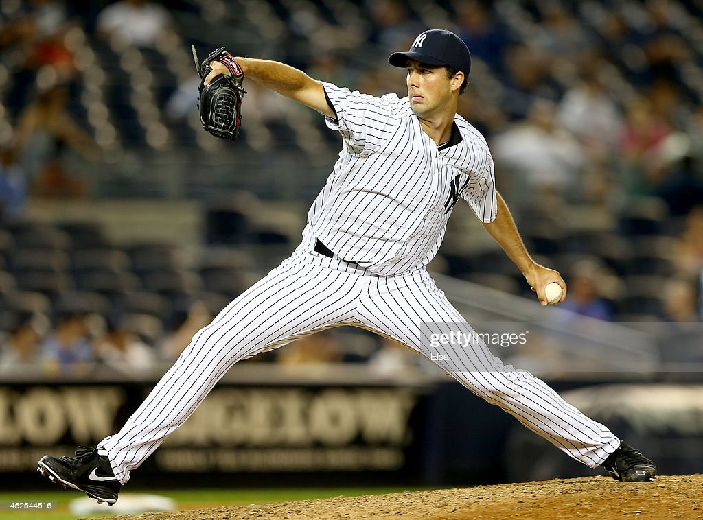 Jeff Francis of the New York Yankees pitches in the 14th inning against the Texas Rangers on July 23 2014 at Yankee Stadium in the Bronx borough of...