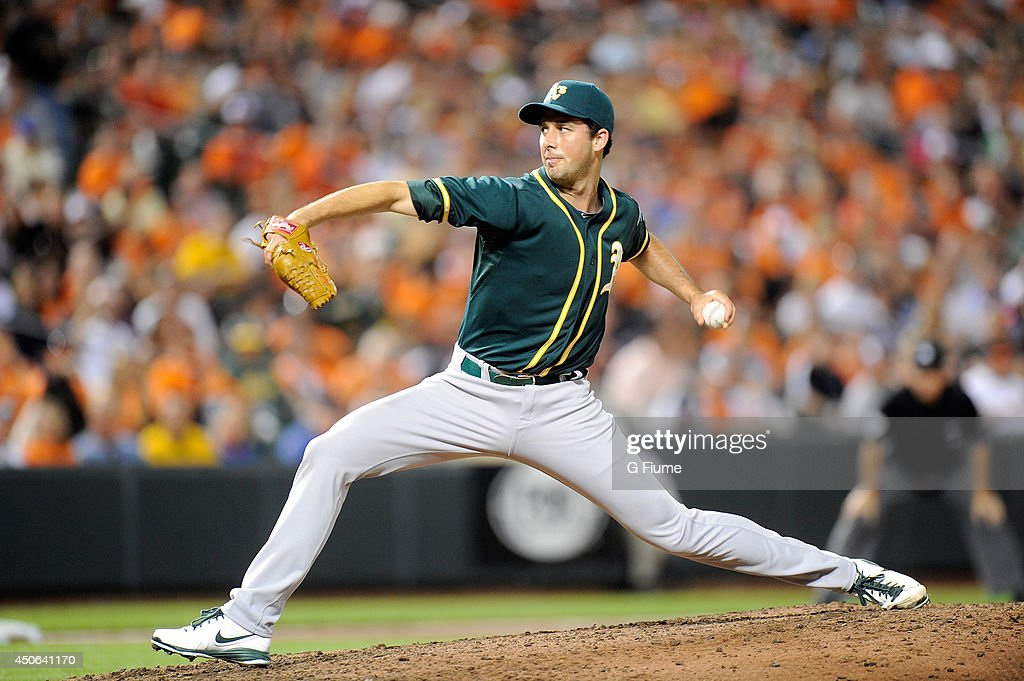 Jeff Francis of the Oakland Athletics pitches against the Baltimore Orioles at Oriole Park at Camden Yards on June 7 2014 in Baltimore Maryland