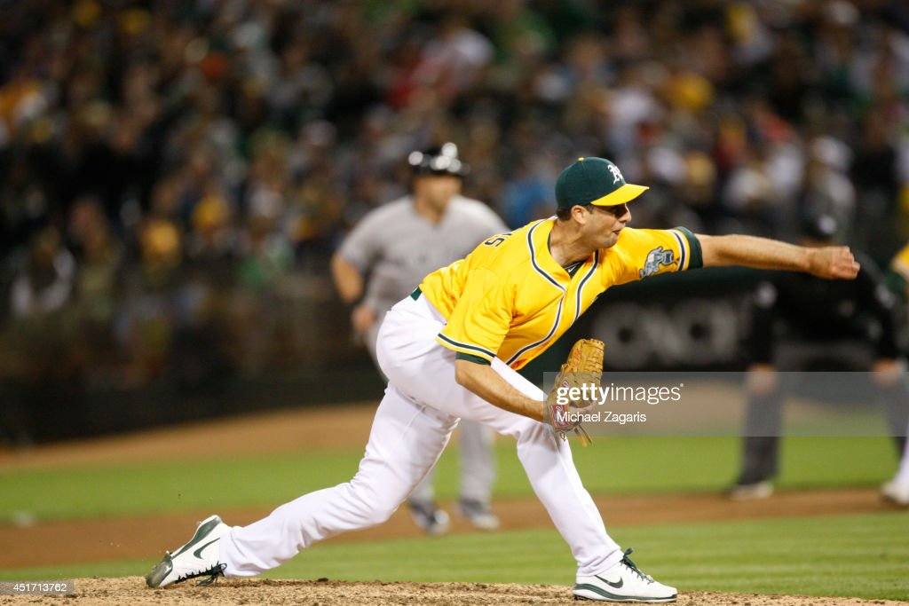 Jeff Francis of the Oakland Athletics pitches during the game against the New York Yankees at Oco Coliseum on June 13 2014 in Oakland California The...
