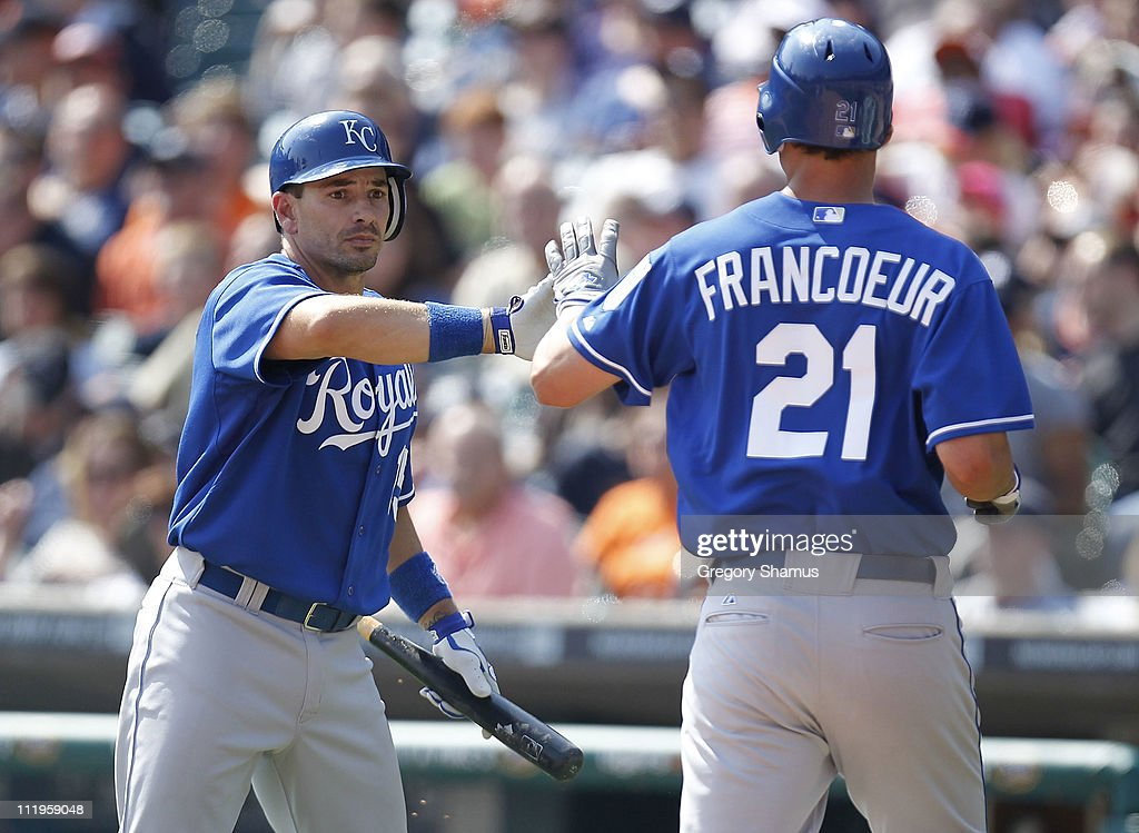 Jeff Francoeur #21 of the Kansas City Royals celebrates a seventhing run with Matt Treanor #15 while playing the Detroit Tigers at Comerica Park on April 10, 2011 in Detroit, Michigan. Kansas City won the game Kansas city won the game 9-5.