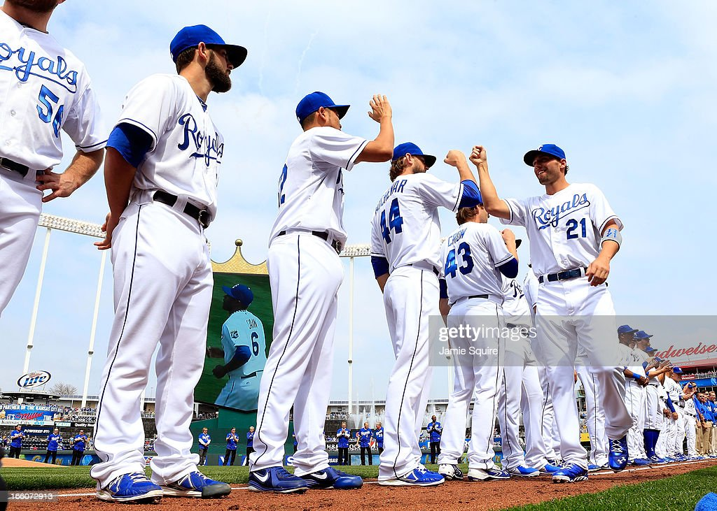 Jeff Francoeur #21 of the Kansas City Royals is greeted by teammates during player introductions prior to the Kansas City Royals home opener against the Minnesota Twins at Kauffman Stadium on April 8, 2013 in Kansas City, Missouri.
