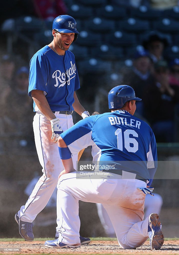 <a gi-track='captionPersonalityLinkClicked' href=/galleries/search?phrase=Jeff+Francoeur&family=editorial&specificpeople=217574 ng-click='$event.stopPropagation()'>Jeff Francoeur</a> #21 of the Kansas City Royals reacts as <a gi-track='captionPersonalityLinkClicked' href=/galleries/search?phrase=Billy+Butler&family=editorial&specificpeople=759092 ng-click='$event.stopPropagation()'>Billy Butler</a> #16 slides in to score a fourth inning run against the Arizona Diamondbacks during the spring training game at Surprise Stadium on February 25, 2013 in Surprise, Arizona.