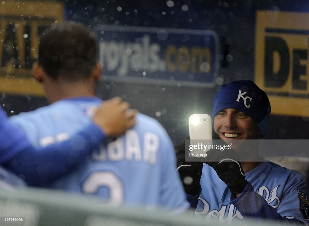 Jeff Francoeur #21 of the Kansas City Royals takes a photo of teammate Alcides Escobar #2 as snow falls during a delay in a game against the Tampa Bay Rays at Kauffman Stadium on May 2, 2013 in Kansas City, Missouri. The game was postponed due to weather.