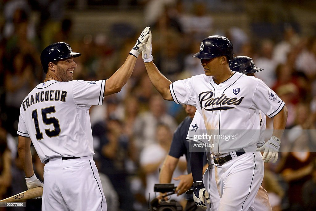 Jeff Francouer #15 congratulates Will Venable #25 of the San Diego Padres after hitting a home run against the St Louis Cardinals at Petco Park on July 30, 2014 in San Diego, California. (Photo by Andy Hayt/San Diego Padres/Getty Images) Will Venable;Jeff Francouer