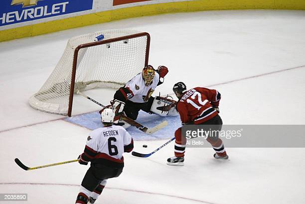 Jeff Friesen of the New Jersey Devils scores the game winning goal against Patrick Lalime of the Ottawa Senators in the 3rd period during game 7 of...
