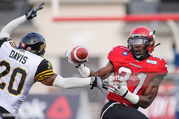 Jeff Fuller of the Calgary Stampeders just misses a catch as Emanuel Davis of the Hamilton TigerCats tries to stop him during a CFL game at McMahon...