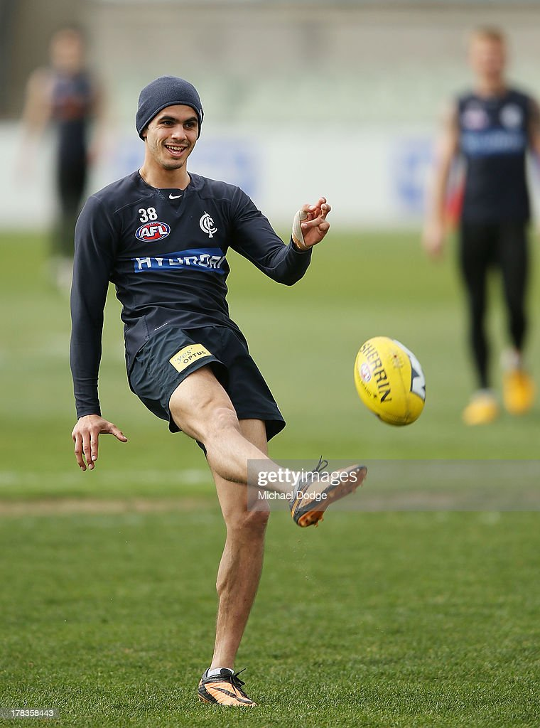 Jeff Garlett kick the ball during a Carlton Blues AFL training session at Visy Park on August 30, 2013 in Melbourne, Australia.