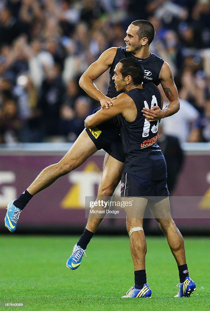 Jeff Garlett of the Blues gets lifted up by <a gi-track='captionPersonalityLinkClicked' href=/galleries/search?phrase=Eddie+Betts&family=editorial&specificpeople=546295 ng-click='$event.stopPropagation()'>Eddie Betts</a> after kicking a goal during the round five AFL match between the Carlton Blues and the Adelaide Crows at Melbourne Cricket Ground on April 27, 2013 in Melbourne, Australia.