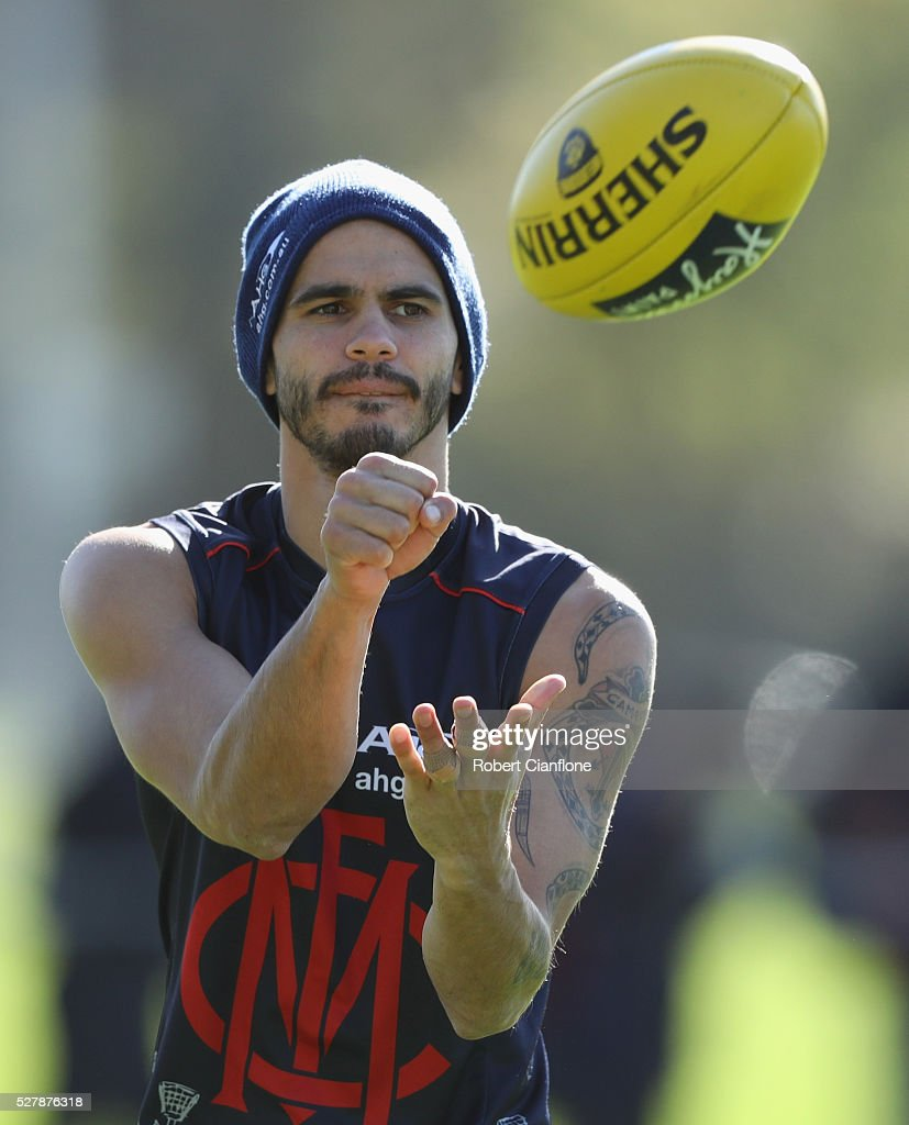 Jeff Garlett of the Demons handballs during a Melbourne Demons AFL training session at Goschs Paddock on May 4, 2016 in Melbourne, Australia.