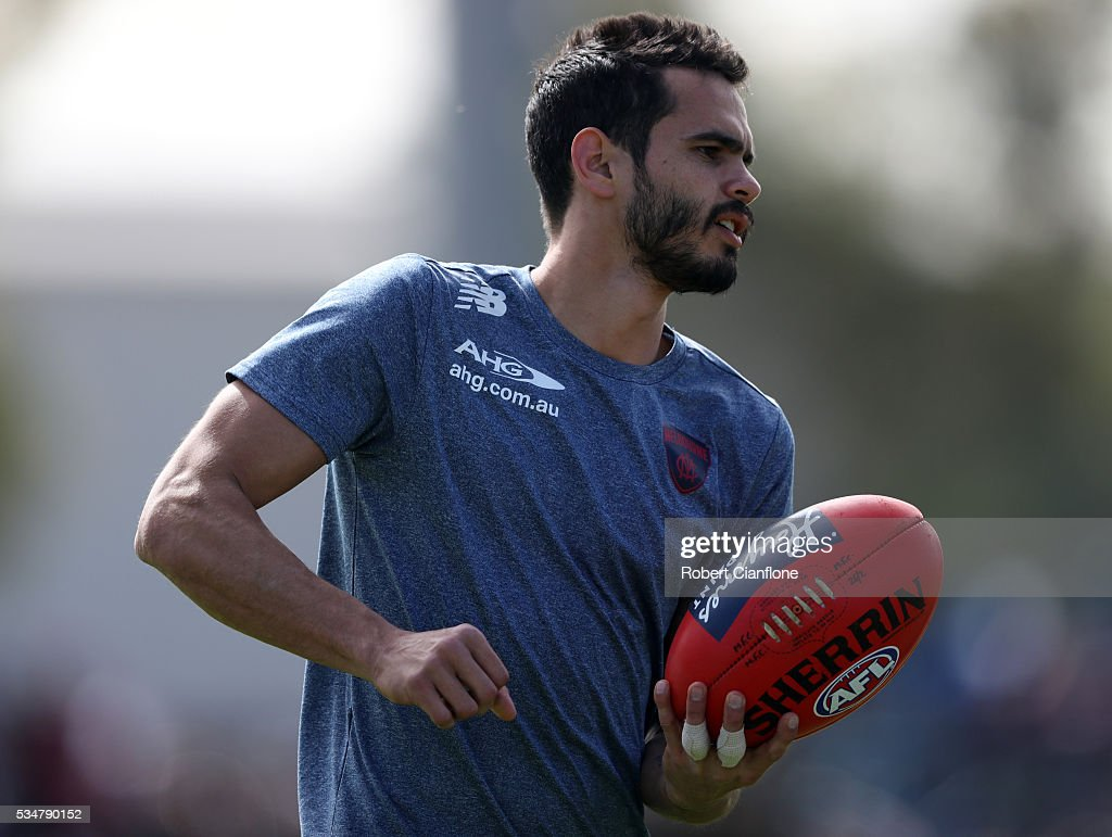 Jeff Garlett of the Demons handballs in the warm up session for the round 10 AFL match between the Melbourne Demons and the Port Adelaide Power at Traeger Park on May 28, 2016 in Alice Springs, Australia.