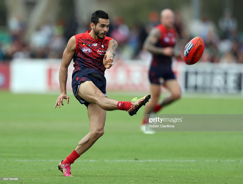 Jeff Garlett of the Demons kicks the ball during the round 10 AFL match between the Melbourne Demons and the Port Adelaide Power at Traeger Park on May 28, 2016 in Alice Springs, Australia.