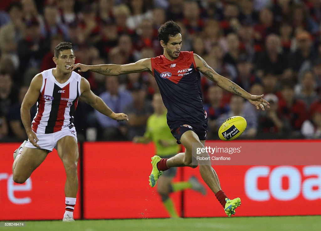 Jeff Garlett of the Demons runs kicks the ball during the round six AFL match between the Melbourne Demons and the St Kilda Saints at Etihad Stadium on April 30, 2016 in Melbourne, Australia.