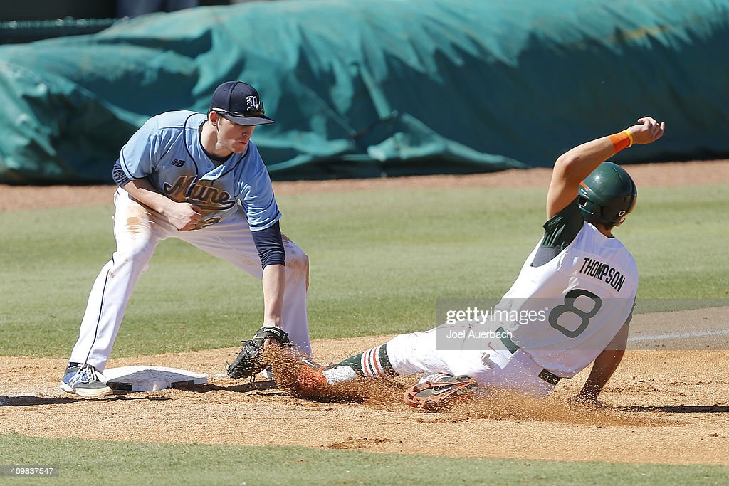 Jeff Gelinas of the Maine Black Bears tags out David Thompson of the Miami Hurricanes as he attempts to take third base in the fourth inning on...