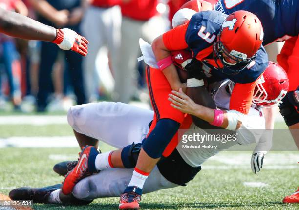 Jeff George Jr #3 of the Illinois Fighting Illini is sacked by Sebastian Joseph of the Rutgers Scarlet Knights at Memorial Stadium on October 14 2017...