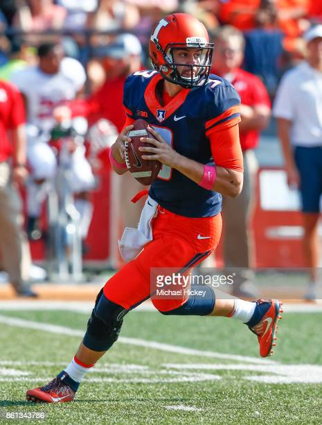 Jeff George Jr #3 of the Illinois Fighting Illini rolls out of the pocket during the game against the Rutgers Scarlet Knights at Memorial Stadium on...