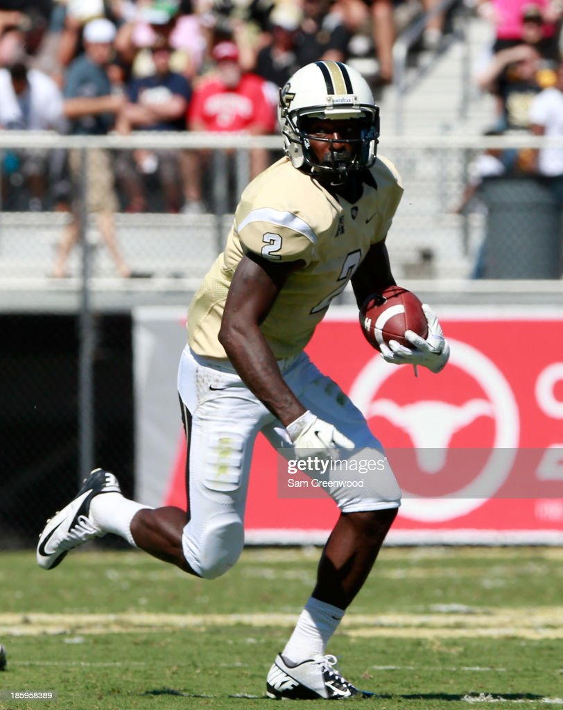 Jeff Godfrey #2 of the UCF Knights runs for yardage during the game against the Connecticut Huskies at Bright House Networks Stadium on October 26, 2013 in Orlando, Florida.
