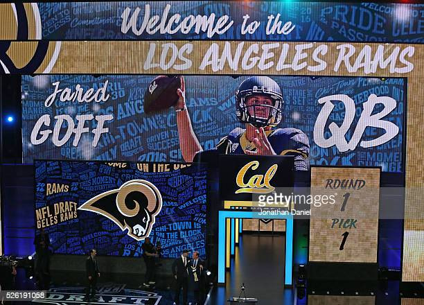 Jeff Goff and Roger Goodell hold Goff's jersey during the 2016 NFL Draft at the Auditorium Theater on April 28 2016 in Chicago Illinois