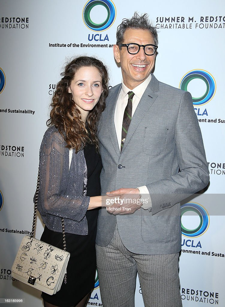 <a gi-track='captionPersonalityLinkClicked' href=/galleries/search?phrase=Jeff+Goldblum&family=editorial&specificpeople=204160 ng-click='$event.stopPropagation()'>Jeff Goldblum</a> (R) an <a gi-track='captionPersonalityLinkClicked' href=/galleries/search?phrase=Emilie+Livingston+-+Gymnast&family=editorial&specificpeople=2419318 ng-click='$event.stopPropagation()'>Emilie Livingston</a> arrive at the 2nd annual an Evening of Environmental Excellence Gala held at a private residence on March 5, 2013 in Beverly Hills, California.
