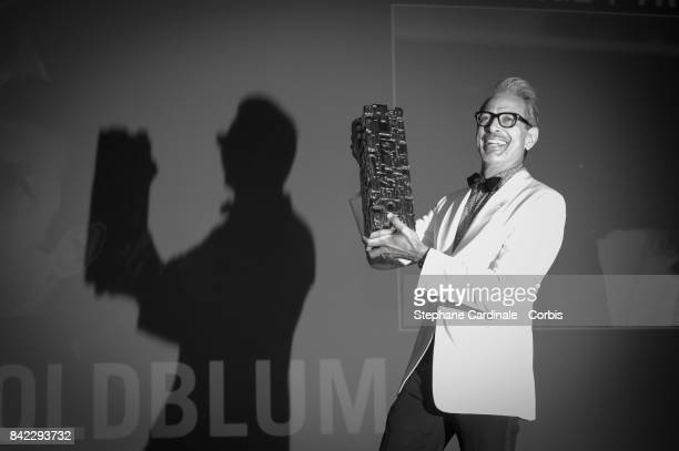 Image has been converted into black and white Jeff Goldblum poses with his achievement tribute award during the 43rd Deauville American Film Festival...