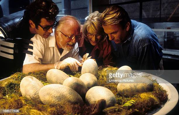 Jeff Goldblum Richard Attenborough Laura Dern and Sam Neill watch dinosaur eggs hatch in a scene from the film 'Jurassic Park' 1993