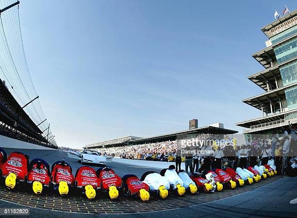 Jeff Gordon and the DuPont Chevrolet team celebrate winning by kissing the famed yard of bricks at the NASCAR Nextel Cup Series Brickyard 400 on...