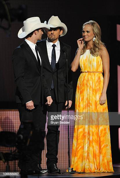 Jeff Gordon Brad Paisley and Carrie Underwood speak onstage at the 44th Annual CMA Awards at the Bridgestone Arena on November 10 2010 in Nashville...