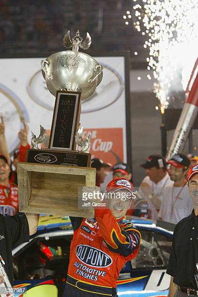 Jeff Gordon celebrates in victory lane after winning the NASCAR Winston Cup Series Sharpie 500 on August 24 2002 at the Bristol Motor Speedway in...