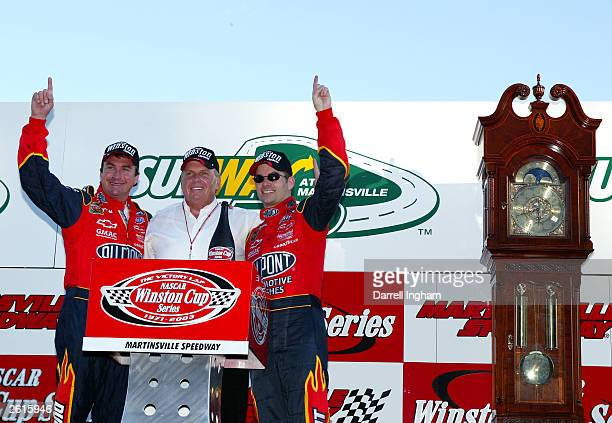 Jeff Gordon celebrates with team owner Rick Hendrick and crew chief Robbie Loomis on winning the NASCAR Winston Cup Subway 500 on October 19 2003 at...