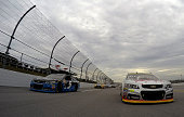 Jeff Gordon driver of the 3M Chevrolet and Kasey Kahne driver of the Time Warner Cable Chevrolet lead the field during the pace laps prior to the...