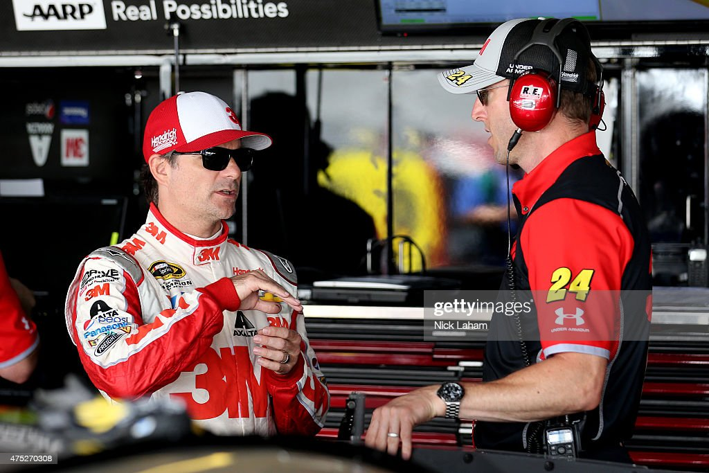 Jeff Gordon driver of the 3M Chevrolet left talks with crew chief Alan Gustafson in the garage area during practice for the NASCAR Sprint Cup Series...