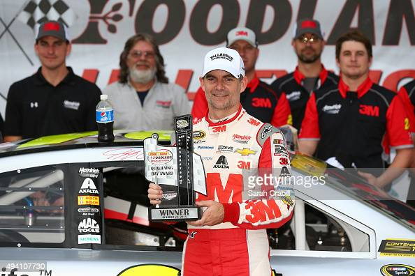 Jeff Gordon driver of the 3M Chevrolet poses with the Coors Light Pole Award after qualifying for the pole position for the NASCAR Sprint Cup Series...