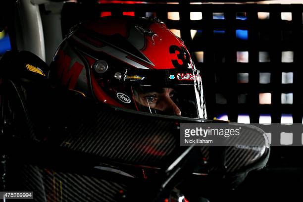 Jeff Gordon driver of the 3M Chevrolet sits in his car in the garage area during practice for the NASCAR Sprint Cup Series FedEx 400 Benefiting...