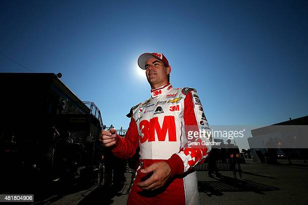 Jeff Gordon driver of the 3M Chevrolet walks through the garage area during practice for the NASCAR Sprint Cup Series Crown Royal Presents the Jeff...
