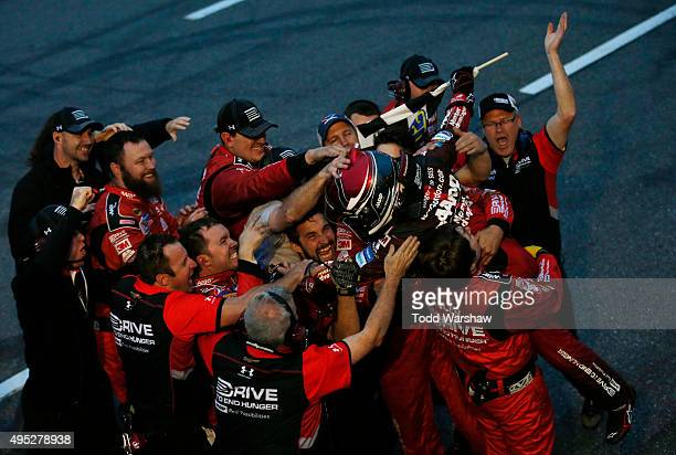 Jeff Gordon driver of the AARP Member Advantages Chevrolet celebrates with his team agfter winning the NASCAR Sprint Cup Series Goody's Headache...