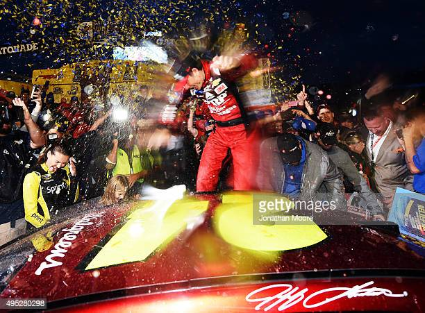Jeff Gordon driver of the AARP Member Advantages Chevrolet celebrates in Victory Lane after winning the NASCAR Sprint Cup Series Goody's Headache...