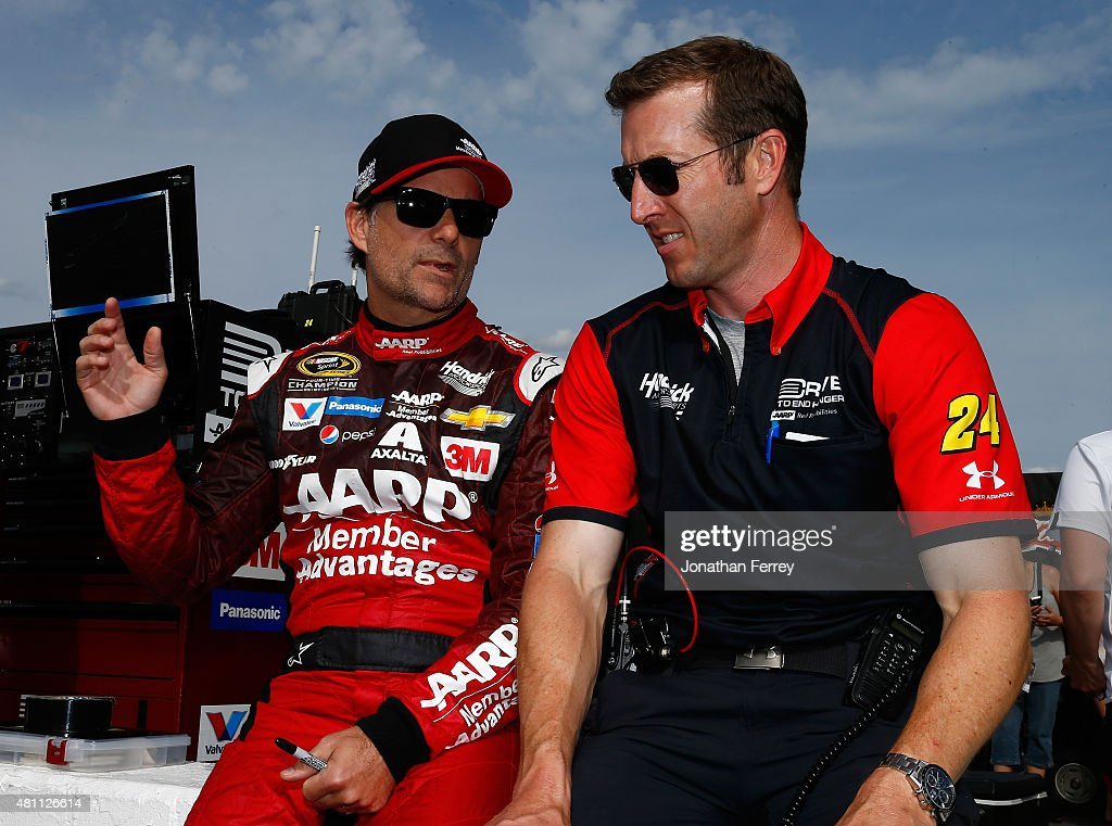 Jeff Gordon driver of the AARP Member Advantages Chevrolet talks with his crew chief Alan Gustafson during qualifying for the NASCAR Sprint Cup...