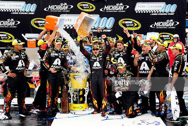 Jeff Gordon driver of the Axalta Chevrolet and Alan Gustafson his crew chief participate in the ALS Ice Bucket Challenge after winning the NASCAR...