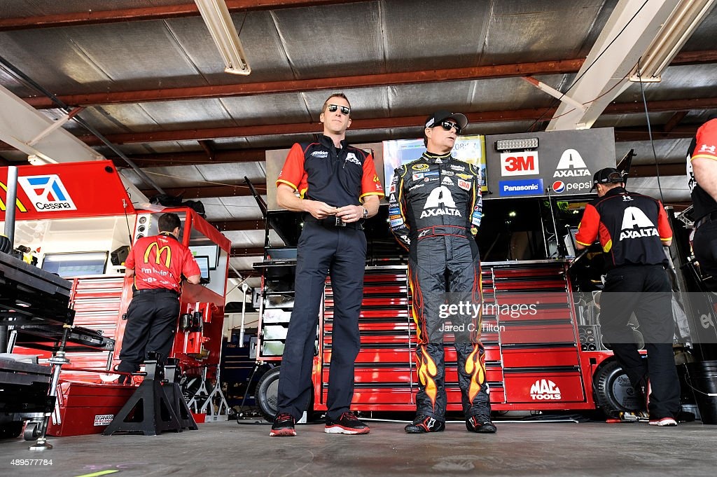 Jeff Gordon driver of the Axalta Chevrolet and crew chief Alan Gustafson stands in the garage area during practice for the NASCAR Sprint Cup Series...