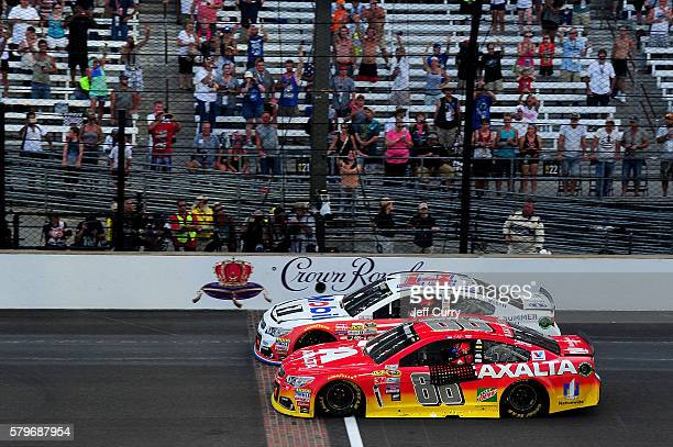 Jeff Gordon driver of the Axalta Chevrolet and Tony Stewart driver of the Mobil 1/Chevy Summer Sell Down Chevrolet take a cooldown lap together after...